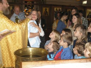 Orthodox practice invites children and all parishioners to get close and participate.